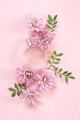 Woman perfume among flowers
