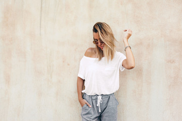 Woman in white t-shirt on beige background Wall mural