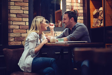 Beautiful couple on a romantic date in cafe