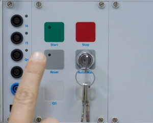 Male Hand Pushing Stop and Reset Buttons of Control Panel for Electrical Equipment in a Smart Factory. Industry 4.0 Concept Smart Factory Automation Line Control.