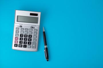 Sliver calculator on vivid blue background