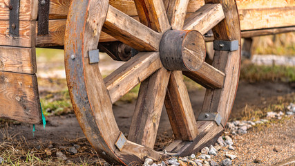 wooden wheels as a background texture for artists and designers