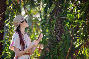 Beautiful Girl Holds Spiky Leaf In Garden
