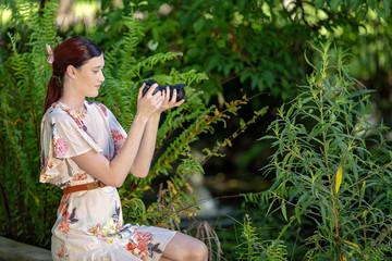 Beautiful Young Woman Taking Photos In Garden