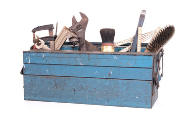 Old toolbox filled with vintage tools