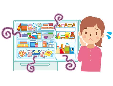乱雑な冷蔵庫と困る女性