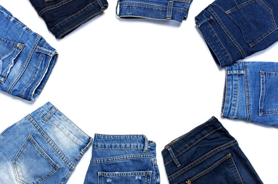 Frame of different blue jeans isolated on white background top view flat lay. Detail of nice blue jeans. Jeans texture or denim background. Trend clothing. Beauty and fashion, clothing concept.