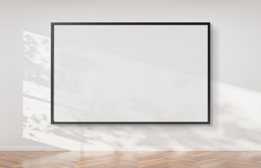Black frame hanging on a wall mockup 3d rendering