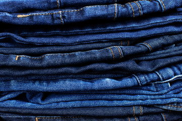 Set of different blue jeans. Detail of nice blue jeans. Jeans texture or denim background. Blue denim jeans texture, fabric grunge background. Beauty and fashion, clothing concept