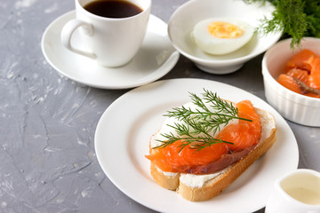 Sandwich with cheese, trout coffee for breakfast.
