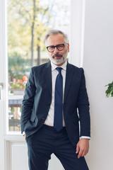 Front portrait of mature businessman in glasses