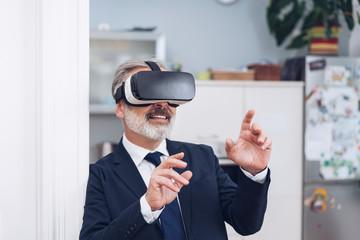 Bearded mature man using 3D glasses
