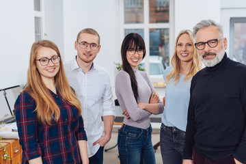 Group photo of team of colleagues in office