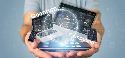 Businessman holding Quantum computing concept with qubit and devices 3d rendering