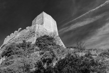 Beautiful black and white view of the Rocca d'Orcia against a dramatic sky, Siena, Tuscany, Italy