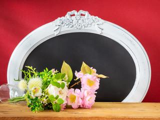 Spring decoration flowers and vintage frame