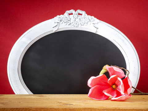Spring decoration magnolia flower and vintage frame