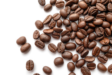 Roasted coffee beans isolated on white background. Close-up.