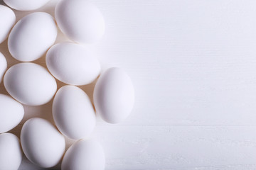 Fotobehang White eggs pattern, on a wooden table.