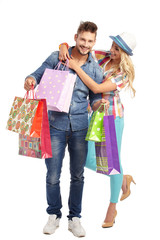 Garden Poster Fairytale World Attractive young couple with shopping bags on white background