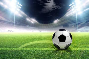 Football stadium soccer with football, stadium lights at night 3d render with dark sky