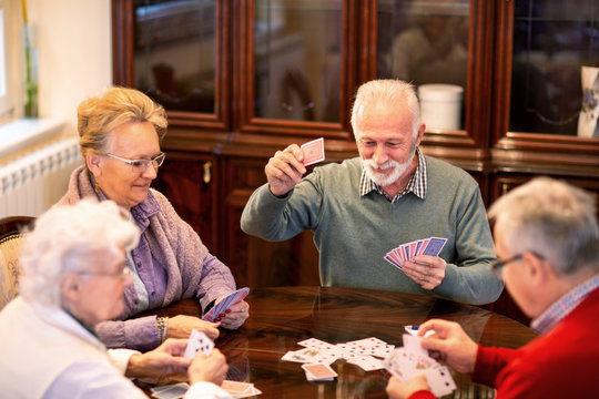 Senior people playing card games