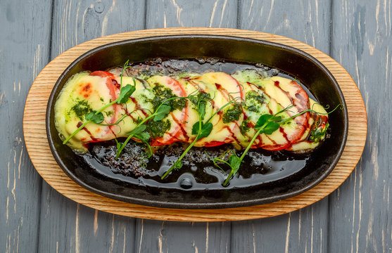 Grilled caprese chicken with mozzarella cheese basil and tomatoes