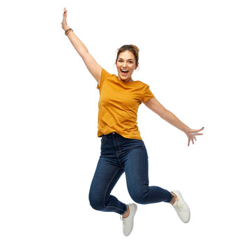 motion, freedom and people concept - happy young woman or teenage girl jumping over white background