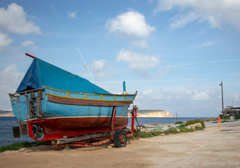 Moored boat on the harbourside in Malta
