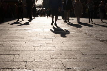 Silhouettes of tourists and shoppers in Malta