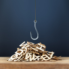 pile of wooden letters with a hook