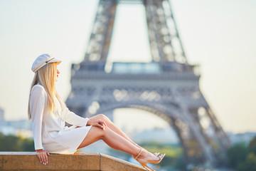 Beautiful blond woman near the Eiffel tower