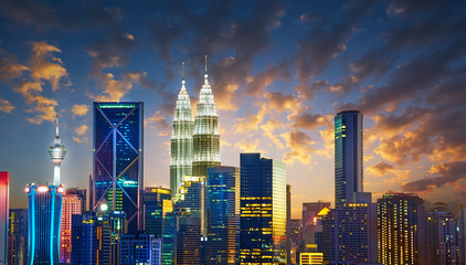 Fotomurales - Kuala Lumpur City skyline with urban skyscrapers at sunset.