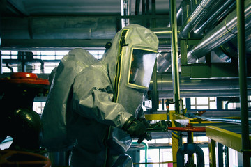 Man in a radiation protection suit.