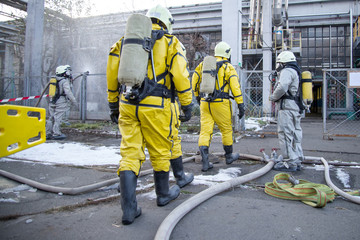 Firefighters and rescuers in a radiation protection, chemical protection suit.