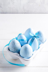 Organic blue easter eggs in porcelain decorative box on white. Holiday concept concept.