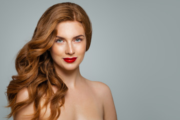 Elegant stylish woman with red hair and red lips makeup. Pretty redhead girl with curly hairstyle