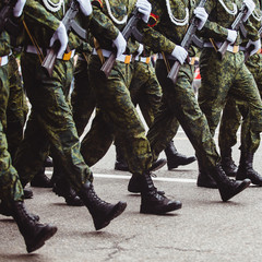 military men in green dress uniform marching to victory parade