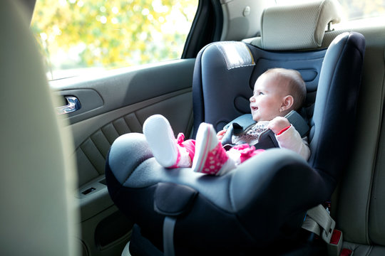 Little baby princess sitting in the cushioned baby seat
