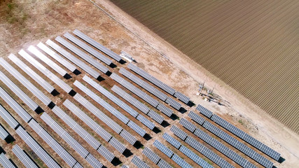 aerial view of solar energy panels and agriculture field