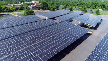 aerial view of solar panels in parking