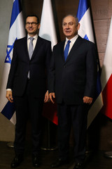 Israeli PM Netanyahu poses for pictures with Poland's PM Morawiecki during the Middle East summit in Warsaw