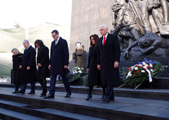 Israeli Prime Minister Benjamin Netanyahu, his wife Sara, U.S. Vice President Mike Pence, his wife Karen, Poland's Prime Minister Mateusz Morawiecki and his wife Iwona leave after laying a wreath at the Monument to the Ghetto Heroes in Warsaw