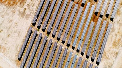 aerial top view of solar power panels in desert, solar farm energy