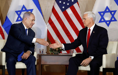 U.S. Vice President Mike Pence and Israeli Prime Minister Benjamin Netanyahu shake hands as they meet in Warsaw
