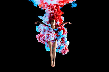 Fototapeta Modern art collage. Concept ballerina with colorful smoke. Abstract formed by color dissolving in water on black background obraz