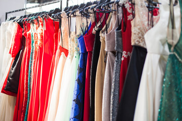 Stand with a colorful evening dresses.