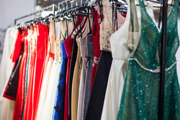 Rack with a multi-colored evening dresses.