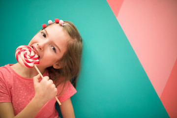 Girl with a Lollipop. On a bright background-Image