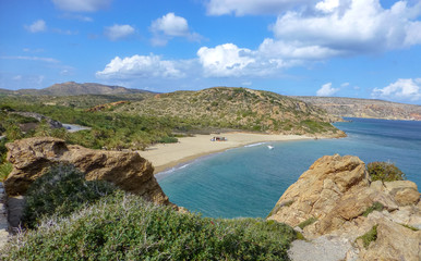 Famous dates palm trees Vai beach with white sand and a lot of shadow on Crete island, Greece
